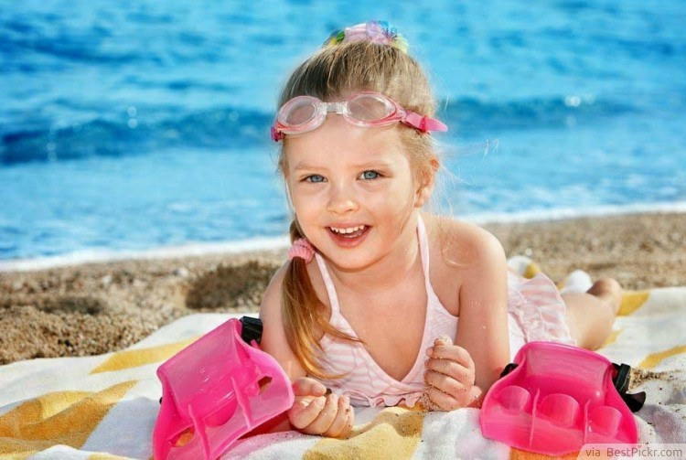 Beautiful Baby Girl On Sand