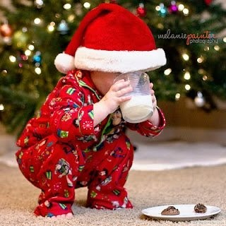 a9d4ad440 Cute Baby Boy In Red Pajama Clothes With Santa Hat